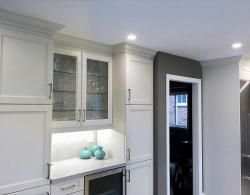 Glass-front doors, in-cabinet lighting, USB port for phone-charging