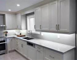Cuisine Ideale Hereford-style door, finished with custom colour, Benjamin Moore Edgecomb Gray;   Caesarstone quartz countertop in Snowy Cliffs