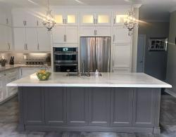 Glass cabinets above wall oven unit, fridge & pantry, Waterfall glass; Pantry cabinets with roll-out drawers