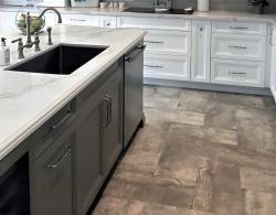 """Caesarstone Statuario Maxium 1-1/2 """" profile with miter edge; 12 x 24"""" Marvel Grigio porcelain flooring in herringbone design; Wine cooler"""