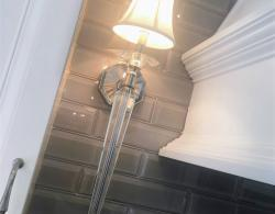 Wall-sconce lighting, beveled glass subway backsplash tiles