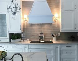 Canopy hood in matching cabinetry; Induction cook top