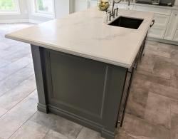 Franke Techna sink; Island with columns at corners with detailed door panels recessed between on the side of island