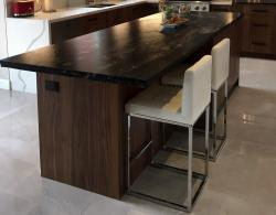 Leathered-finish island countertop in granite; Island seating and storage areas