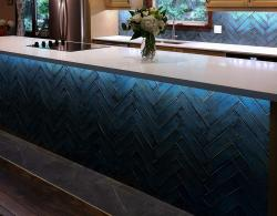 Alchimia Blue polished ceramic subway tile, 3 x 12 inch, showcased with island lighting installed by homeowner