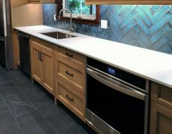 """12 x 24"""" Madison Grafito porcelain floor tiling; Whirpool convection wall oven in fingerprint-resistant stainless steel"""
