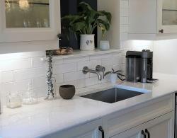 "Wall-mount faucet; 24"" single sink for bar area; undercabinet lighting Kestle design"