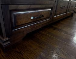 Westport raised panel door in Noyer Natural & black patine