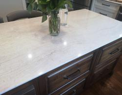Cambria quartz countertop in Ironsbridge, a  mixture of honey accents with different shades of cream, whites and grays
