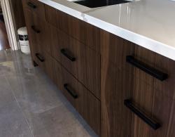 "24"" x 24"" polished Alabastro Sand porcelain floor tiles; Book-matched vertical-grain, natural-walnut cabinetry, Cuisine Ideale York door style"