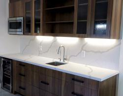 Book-matched vertical-grain, natural-walnut cabinetry, Cuisine Ideale York door style