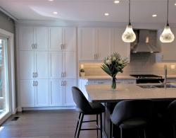 "Brome door style, Ultra white lacquer; Diamante Polvera 4 x 12"" floor tile; Kestle Interiors kitchen design Newmarket"