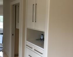 Open niche in hallway storage cabinetry designed to accommodate keys, phones, charging cords