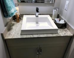Square vessel sink; quartz Moorland Fog countertop Newmarket design Kestle Interiors