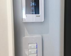 Programmable Radiant floor heating thermostat, Switches control variable lighting values; Kestle Interiors design Newmarket