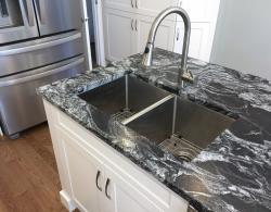 Kitchen renovation Kestle Interiors, leathered granite, marble backsplash Newmarket
