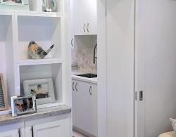 Laundry room accessible by feature barn door off family room
