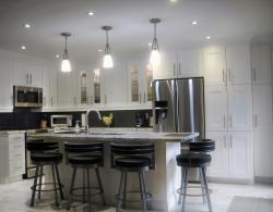 Under-wall-cabinet task lighting, pendant lighting over island and pot lighting