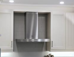 Wall-mounted Miele, stainless-steel hood with LED lighting and light-touch switch for easy use;Kestle Interiors Newmarket Kitchen Design