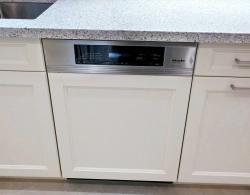 Miele panel-ready dishwasher, with applied matching door panel