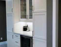 Tall pantry units; glass door fronts for display, undercounter lighting, in-cabinet lighting