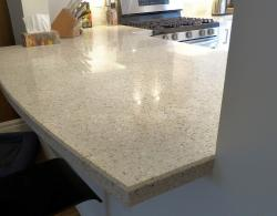 "Quartz countertop, 1-1/2 "" profile, soft-curve shape, bar-stool-height seating"