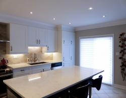 This Frost-white kitchen is bright and modern with efficient traffic flow.