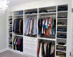 Bedroom converted to walk-in closet, with open concept, opposite walls of floor-to-ceiling, His & Hers closet space