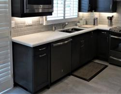 Quartz countertop, stained maple doors, porcelain floor tiles