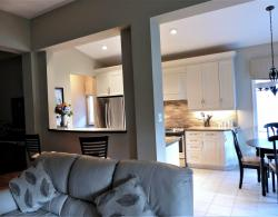 Raised countertop between living room and kitchen provides an informal dining with a pass-through window to the kitchen