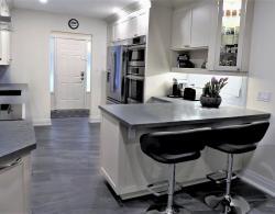 12 x 24 River Grafito Floor tiles; Quartz countertops; Cabinetry in Edgecomb Gray