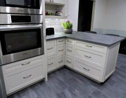 Quartz countertop in Rugged Concrete; Peninsula creating additional workspace & seating area