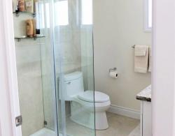 A glass-wall shower with acrylic shower base was added to make this bathroom more functional.  LED potlights installed in the ceiling, with dimmer switch for lighting control.