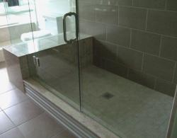 A combination of natural stone and man-made material creates a luxurious and functional bathroom.