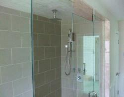Spacious shower includes body jets and rain-head.