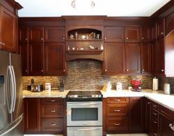 Shaker-style door in maple with custom stain, stone-tile backsplash