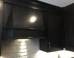 Canopy hood in matching finish to cabinets, with inset extractor ducted outside