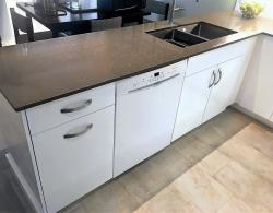 K-Stone quartz countertop in Cioccolato; Stainless-steel double sink