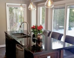 """Edison light bulbs for task lighting, granite countertop, with undermount contempoary double square sink, 10"""" deep"""